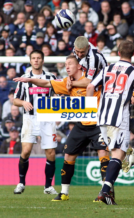 Photo: Mark Stephenson/Sportsbeat Images.<br /> West Bromwich Albion v Wolverhampton Wanderers. Coca Cola Championship. 25/11/2007.west Brom's Paul Robinson climbes above Wolves Freddy Eastwood to win the ball