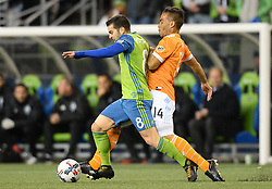 November 30, 2017 - Seattle, Washington, U.S - Soccer 2017: VICTOR RODRIGUEZ (8) and ALEX (14) battle for the ball as the Houston Dynamo play the Seattle Sounders in the 2nd leg of the MLS Western Conference Finals match at Century Link Field in Seattle, WA. (Credit Image: © Jeff Halstead via ZUMA Wire)