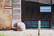 Conflicting parking signs pointing left and right. Agde town. Languedoc. The gate. France. Europe.