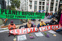 London, UK. 7 October, 2019. Climate activists from Extinction Rebellion block a road close to the Home Office on the first day of International Rebellion protests to demand a government declaration of a climate and ecological emergency, a commitment to halting biodiversity loss and net zero carbon emissions by 2025 and for the government to create and be led by the decisions of a Citizens' Assembly on climate and ecological justice.