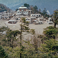 A forest surrounds Tengboche Monastery in ithe Khumbu region of Nepal's Himalaya.  Shot in 1974, before the modern onslaught of climbers and trekkers began & this temple burned & was rebuilt more safely.