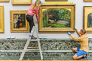 The return and re-hanging of the nation's Pre-Raphaelite works, including Millais' Ophelia (pictured right), to Tate Britain. They are going back on display from Thursday 7 August 2014 after being seen by over 1.1 million people worldwide. They include: John Everett Millais' , Ophelia; Beata Beatrix by Dante Gabriel Rossetti; The Lady of Shalott by John William Waterhouse ; The Beloved by Rossetti; and Mariana  (pictured left)  by John Everett Millais. These works are being displayed in the 'grand' surroundings of the 1840 galleries as part of the BP Walk through British Art. <br /> Millbank,  London, UK.