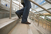 low angle view of a person walking down the stairs