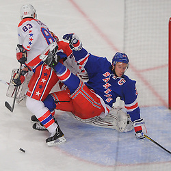 April 7, 2012: New York Rangers right wing Ryan Callahan (24) is dropped to the ice by Washington Capitals center Jay Beagle (83) in goalie Braden Holtby's (70) crease during second period NHL hockey action between the Washington Capitals and the New York Rangers at Madison Square Garden in New York, N.Y.