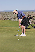 Vertical of golfer putting, Taos Country Club