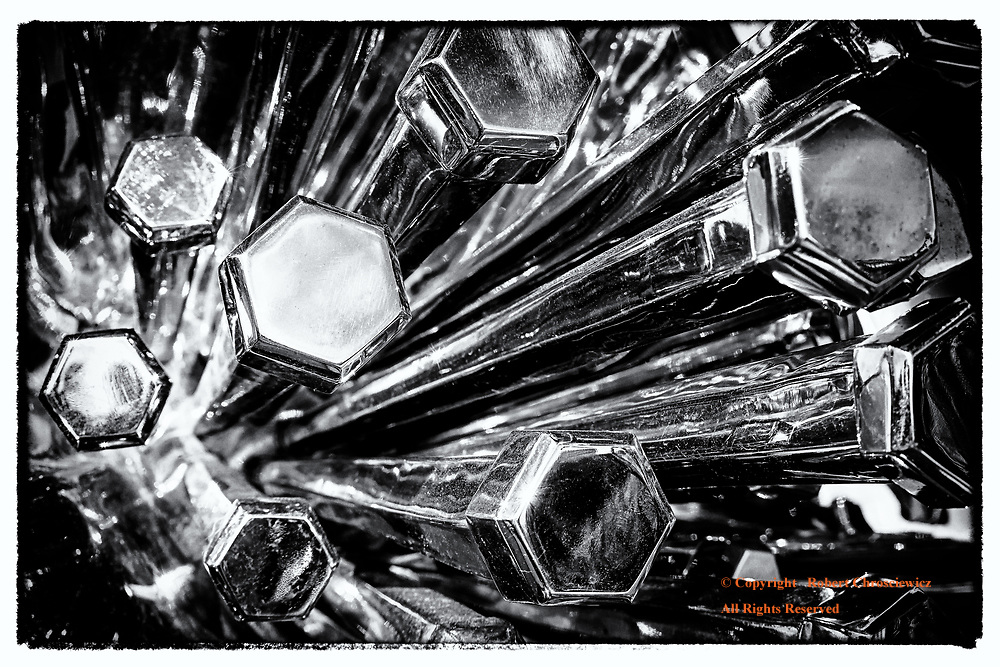 Reflective Art (B&W): This close-up view of a metallic sculpture on a sunny day, in front of the city hall, Vancouver Canada.