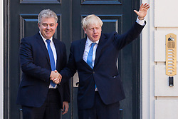 London, UK. 23 July, 2019. Boris Johnson is welcomed at the headquarters of the Conservative Party by party Chairman Brandon Lewis following the announcement that he had been elected as the party leader and would tomorrow replace Theresa May as Prime Minister.
