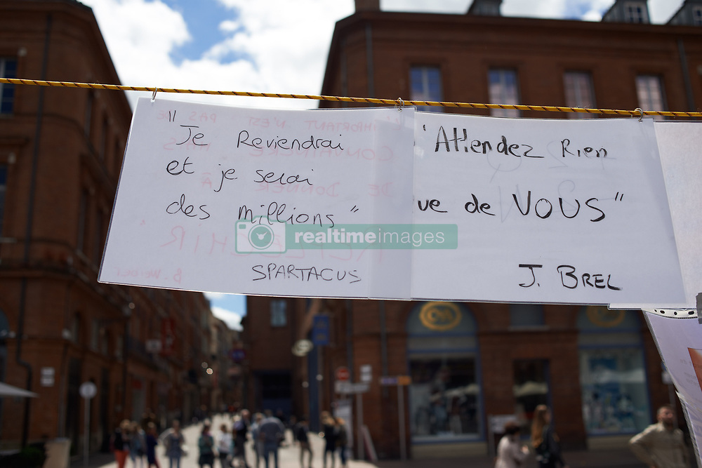 May 7, 2017 - Toulouse, France - During the second round of the French presidential election, the movement 'Jour Debout' (ie Up All Day) organized a false mass for the election called 'The mass of the very holy election' to prone abstention. It was organized on the Place du Capitole in Toulouse, France, on 7 May 2017. Similar actions were organized throught France. A paper reading 'I will come back and I will be millions. Spartacus' (Credit Image: © Alain Pitton/NurPhoto via ZUMA Press)