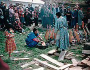 CS00378-02. Cooking fish at the Feast of the First Salmon, Celilo Indian village, April 24, 1955.