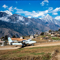 A Twin Otter STOL plane lands at Lukla airstrip in the Khumbu region of Nepal 1986.