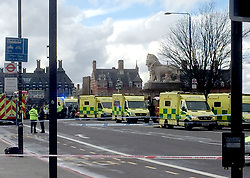 Ambulances on Westminster Bridge, London after policeman has been stabbed and his apparent attacker shot by officers in a major security incident at the Houses of Parliament.