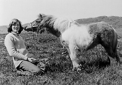 Library filer ref 196834-7, of Diana, Princess of Wales, with Souffle the Shetland pony at her mother's home in Scotland in 1974. It was reported this morning (Sunday) that the princess has been killed in a car crash in Paris. PA. **Available b./w only**