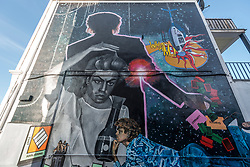 © Licensed to London News Pictures. 17/09/2020. LONDON, UK.  A 9m tall mural of the late George Michael has been unveiled in Kingsbury, north west London where the Wham! star lived and went to school until his early teens.  The mural has been created by artist Dawn Mellor and includes a montage of scenes from the history and life of Kingsbury.  The work is part of Brent 2020, London Borough of Culture, and the Brent Biennial which runs from 19 September to 13 December.  Photo credit: Stephen Chung/LNP