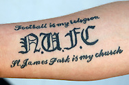 """a Tattoo which reads  """"Football is my Religion N.U.F.C St. James Park is my church"""" is seen on the arm of a Newcastle United fan. EFL Skybet football league championship match, Queens Park Rangers v Newcastle Utd at Loftus Road Stadium in London on Tuesday 13th September 2016.<br /> pic by John Patrick Fletcher, Andrew Orchard sports photography."""