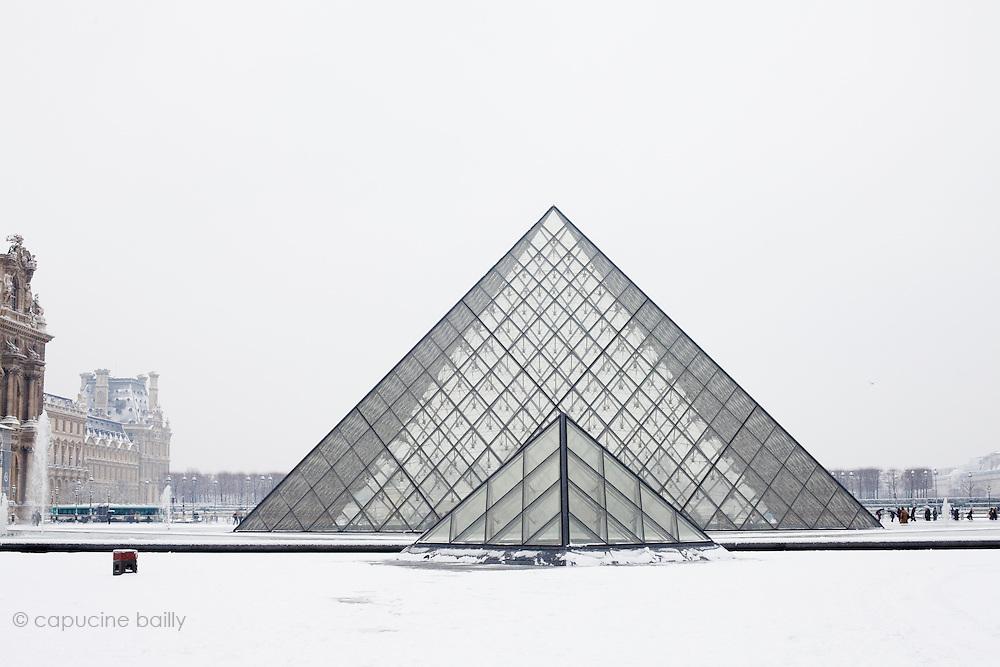 Paris, France. December 17th 2009..Pyramides du Louvre - Cour Napoléon (1st Arrondissement)