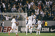 Los Angeles Galaxy defender A.J. DeLaGarza, top, celebrates scoring with Galaxy defender Omar Gonzalez (4) during the first half of the CONCACAF Champions League semifinal, Wednesday, April 3, 2013, in Carson, Calif. (AP Photo/Bret Hartman)