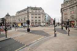 © Licensed to London News Pictures. 19/03/2020. London, UK. Oxford Circus appears quiet this afternoon . New cases of the COVID-19 strain of Coronavirus are being reported daily as the government outlines it's plans for controlling the outbreak. Photo credit: George Cracknell Wright/LNP