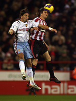 Photo: Paul Thomas.<br /> Sheffield United v Aston Villa. The Barclays Premiership. 11/12/2006.<br /> <br /> Milan Baros (L) of Villa is out jumped by Leigh Bromby.