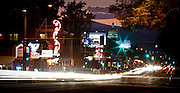 """SHOT 8/27/09 8:08:50 PM - Colfax Avenue is the main street that runs east and west through the Denver-Aurora metropolitan area in Colorado. As U.S. Highway 40, it was one of two principal highways serving Denver before the Interstate Highway System was constructed. In the local street system, it lies 15 blocks north of the zero point (Ellsworth Avenue, one block south of 1st Avenue). For that reason it would normally be known as """"15th Avenue"""" but the street was named for the 19th-century politician Schuyler Colfax. On the east it passes through the city of Aurora, then Denver, and on the west, through Lakewood and the southern part of Golden. Colloquially, the arterial is referred to simply as """"Colfax"""", a name that has become associated with prostitution, crime, and a dense concentration of liquor stores and inexpensive bars. Playboy magazine once called Colfax """"the longest, wickedest street in America."""" However, such activities are actually isolated to short stretches of the 26-mile (42 km) length of the street. Periodically, Colfax undergoes redevelopment by the municipalities along its course that bring in new housing, trendy businesses and restaurants. Some say that these new developments detract from the character of Colfax, while others worry that they cause gentrification and bring increased traffic to the area. Includes nighttime long-exposure shots of the area around Colfax Avenue and Race Street. (Photo by Marc Piscotty / © 2009)"""