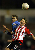 Photo: Richard Lane.<br /> Birmingham City v Sunderland. FA Cup 5th Round Replay. 25/02/2004.<br /> Tommy Smith is challenged by Kenny Cunningham.