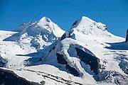 Castor & Pollux, seen from Gornergrat. Zermatt, Pennine/Valais Alps, Switzerland, Europe. In Zermatt, the Gornergrat rack railway (GGB) takes you to a spectacular ridge (at 3135 m or 10,285 ft) between Gornergletscher and Findelgletscher, with views of more than twenty 4000-meter-high peaks. Gornergrat train, opened in 1898, climbs almost 1500 m or 4900 ft via Riffelalp and Riffelberg.