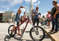 "Gabriel Bates had tried his hand at the ""slow race"" in Veteran's Square but was too fast on his West Coast Choppers bicycle Thursday afternoon.    (Karen Bobotas/for the Laconia Daily Sun)"