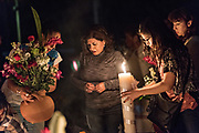 A woman light candles around the gravesite of a family member during the Day of the Dead festival October 31, 2017 in Tzintzuntzan, Michoacan, Mexico.