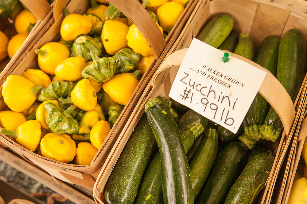 Baskets of zucchini and pattypan squash for sale at Walker's Roadside Stand, Little Compton, Rhode Island.