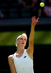 Naomi Broady in action against Garbine Muguruza on day two of the Wimbledon Championships at the All England Lawn Tennis and Croquet Club, Wimbledon.