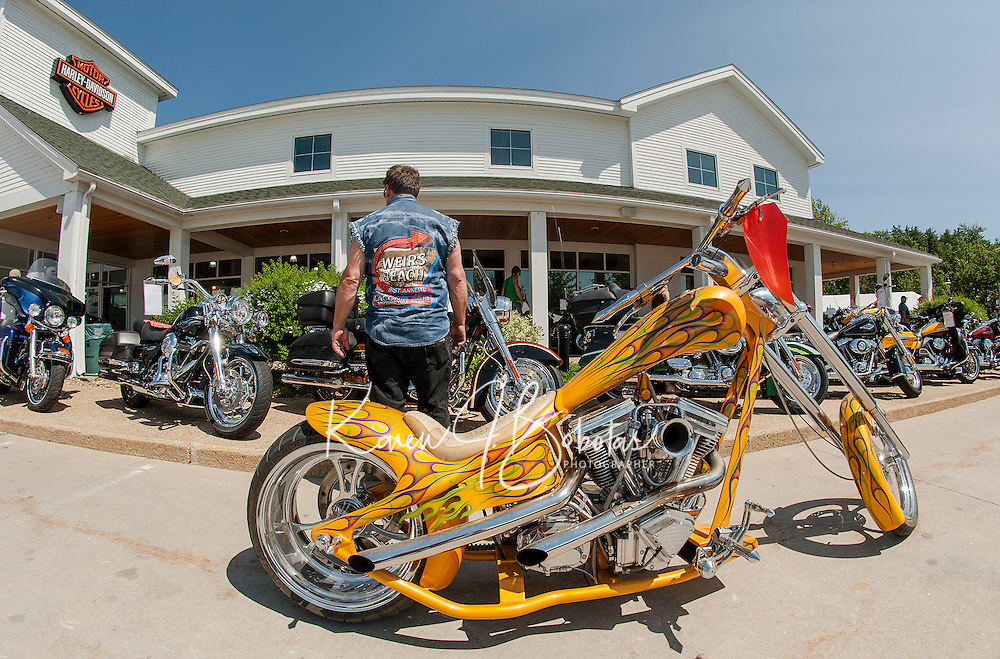 """Weirs Beach is that way but John Shea of Lynnfield MA enjoyed motorcycle """"eye candy"""" including this 2002 Eddie Trotter Camel Back at Laconia Harley Davidson in Meredith Thursday afternoon.  (Karen Bobotas/for the Laconia Daily Sun)"""