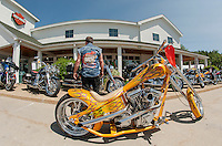"Weirs Beach is that way but John Shea of Lynnfield MA enjoyed motorcycle ""eye candy"" including this 2002 Eddie Trotter Camel Back at Laconia Harley Davidson in Meredith Thursday afternoon.  (Karen Bobotas/for the Laconia Daily Sun)"
