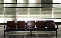 Passenger seating on platform at Potsdamer Platz railway station Berlin 2009
