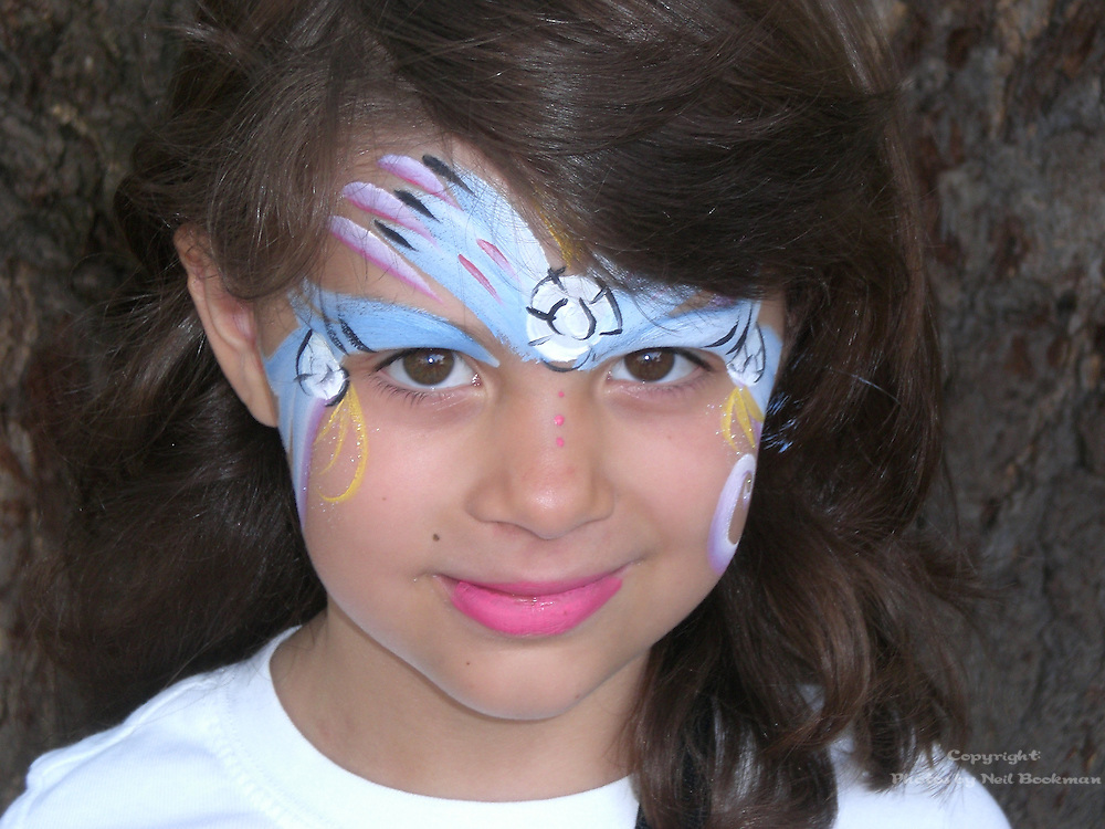 A beautiful young girl with a painted face.