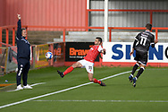 Cheltenham Town midfielder Matty Blair (11) goes full stretch in an attempt to keep the ball in play during the EFL Sky Bet League 2 match between Cheltenham Town and Crawley Town at Jonny Rocks Stadium, Cheltenham, England on 10 October 2020.