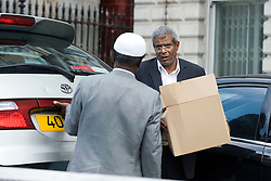 © licensed to London News Pictures.  29/07/2011. London, UK. a box being carried from Libyan Embassy today (29/07/2011) as staff left. Today is the deadline for the charges d'affaires, the most senior Libyan representative in the UK, to leave the country. Britain has granted political recognition to the Libyan opposition the deadline for the Charges. Photo credit: Ben Cawthra/LNP
