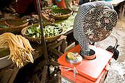 14 MARCH 2006 - PHNOM PENH, CAMBODIA: A sugar cane vendor works in the pasr char or Old Market in central Phnom Penh, Cambodia. Photo by Jack Kurtz / ZUMA Press