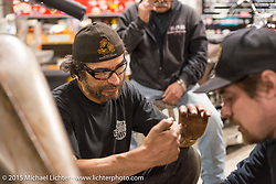 "Bill Dodge's ""Blings Cycles"" custom shop where friends meet up and work on their bikes after a long day at Daytona Beach Bike Week 2015. FL, USA. Monday March 9, 2015.  Photography ©2015 Michael Lichter."