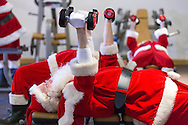 EDITORIAL USE ONLY<br /> Members of The Ministry of Fun's Santa School, dressed as Father Christmas,  work out to get 'chimney-ready' as they attend a special  Santa Boot Camp at the new David Lloyd Club, Newbury PRESS ASSOCIATION Photo. Picture date: Tuesday November 24, 2015. The super intensive pre-Christmas training programme included sessions in David Lloyd's state-of-the-art gym to build strength for all that heavy present lifting, a Santa Spin Session, an Aqua class in the heated pool for stamina and sleigh-ready agility, a bespoke 'Legs, Bums and Tums' class with the emphasis on Santa-sized 'Tums' – and Yoga. Photo credit should read: Chris Ison/PA Wire