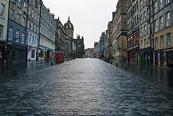 Edinburgh, Scotland, UK. 5 January 2020. Views of a virtually deserted Edinburgh City Centre as Scotland wakes up to the first day of a new strict national lockdown announced by Scottish Government to contain new upsurge in Covid-19 infections. Pic; The Royal Mile in the Old town is almost deserted with no tourists evident.   Iain Masterton/Alamy Live News