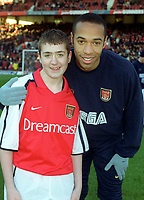 Thierry Henry with the Arsenal mascot before the match. Arsenal 2:2 Sunderland. FA Carling Premiership, 30/12/2000. Credit Colorsport / Stuart MacFarlane.