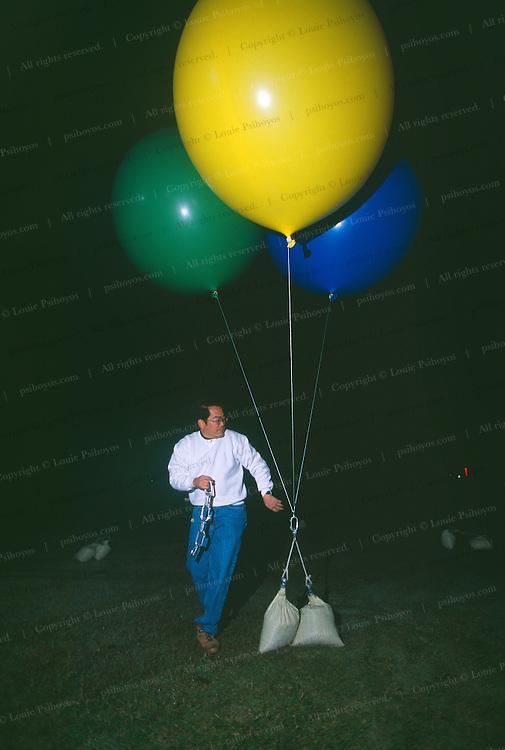 John Ninomiya, a cluster balloonist, preps his balloons at the Coalinga, California.