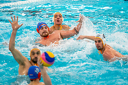 Jorn Winkelhorst of the Netherlands in action against Vasilije Radovic of Montenegro during the Olympic qualifying tournament. The Dutch water polo players are on the hunt for a starting ticket for the Olympic Games on February 19, 2021 in Rotterdam