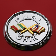 The emblem on a 1957 Duel Ghia D-500 at the Greenwich Concours d'Elegance Festival of Speed and Style featuring great classic vintage cars. Roger Sherman Baldwin Park, Greenwich, Connecticut, USA.  2nd June 2012. Photo Tim Clayton