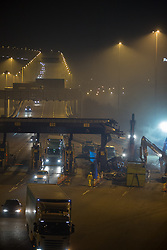 @Licensed to London News Pictures 29/11/2014. Dartford Crossing, South Orbital Road, Dartford, Kent. The first phase of barrier removals start in the early hours of today 30/11/2014. Payment booths at the Dartford Crossing will be removed and replaced with a remote charging system known as Dart Charge. Photo credit: Manu Palomeque/LNP