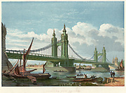 Chelsea Bridge, London. Suspension bridge over  the Thames, opened in 1858, connecting Chelsea with Battersea on the south bank of the river.  It was replaced in the 1930s. Engineer, Thomas Page (1803-1877).  Cost of construction £83,319.  When first opened it was a toll bridge, free for foot traffic on Sundays and Bank Holidays.  In 1879 tolls were abolished.  From 'The Illustrated London News'. (London, September 1858).  Chromolithograph.