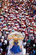 Bolivia. Tarija. Festa di San Roque..At the end of the procession Chunchos sing the song to San Roque, at the end of which a specific verse speaks of kneeling, anyone the thing they do.