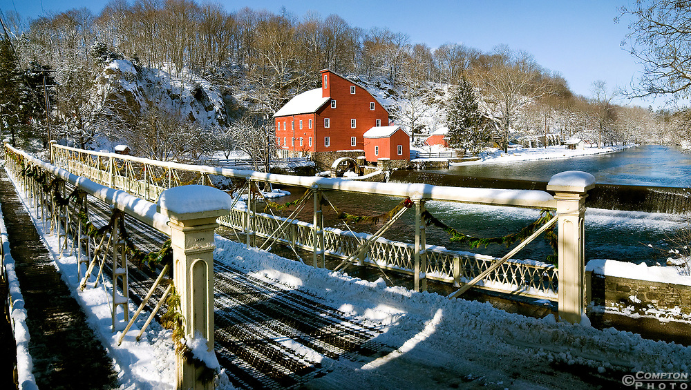 The historic Red Mill and bridge in Clniton NJ in winter