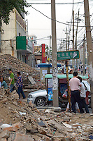 China, Beijing, Chaoyang, San Jian Fang, 2008. Looking east on Chaoyang Lu, far from the city center, chaos reigns as small businesses are torn down in a massive street widening project..