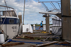 October 8, 2016 - St. Augustine Beach, Florida, U.S. - WILL VRAGOVIC   |   Times.Walker Davis, 16, a worker with King's Marine, checks on client's boats docked at the Conch House Marina Resort in the aftermath of Hurricane Matthew in St. Augustine Beach, Fla. on Saturday, Oct. 8, 2016. (Credit Image: © Will Vragovic/Tampa Bay Times via ZUMA Wire)