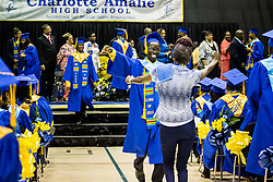 Graduate Tarique Fahie, gets a big hug from mom Felicia Brazier after receiving his diploma.  Charlotte Amalie High School 85th Annual Commencement Program at UVI Sports and Fitness Center.  14 June 2015.  © Aisha-Zakiya Boyd